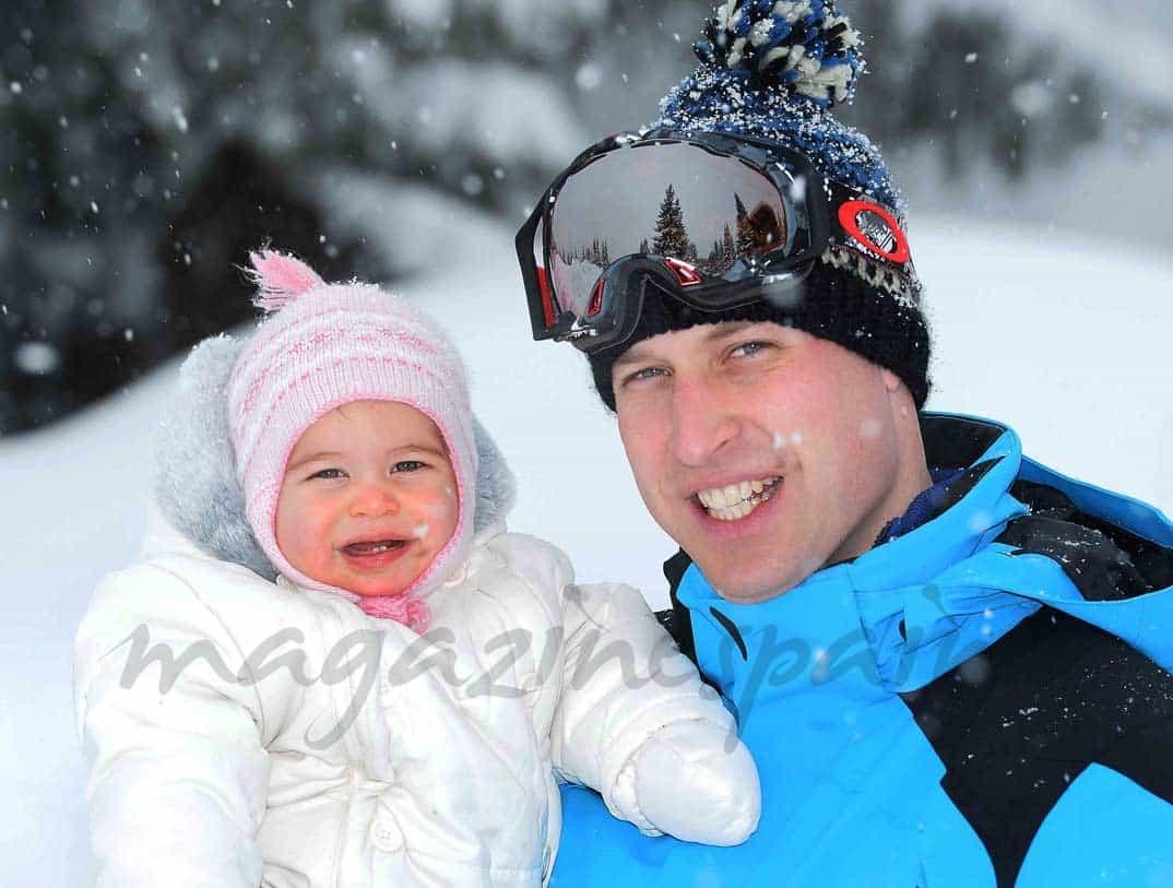 principe guillermo con su hija en la nieve